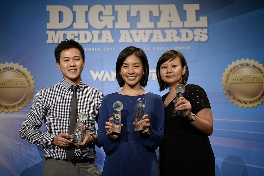 (From left) Mr Desmond Lim, photographer from The Straits Times (ST); Ms Nurulnadiah Md Noh, content producer from ST Online; and Ms Ong Hwee Hwee, assistant news editor from ST, at the 2013 Asian Digital Media Awards on Wednesday, Nov 13, 2013.