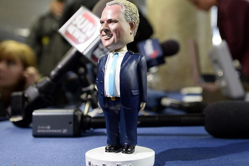 A Toronto mayor Rob Ford bobblehead doll is seen at City Hall in Toronto on Nov 12, 2013. Hundreds of people lined up at Toronto City Hall on Tuesday to buy a limited-edition bobblehead doll of embattled Mr Ford, and by mid-afternoon some were on sal
