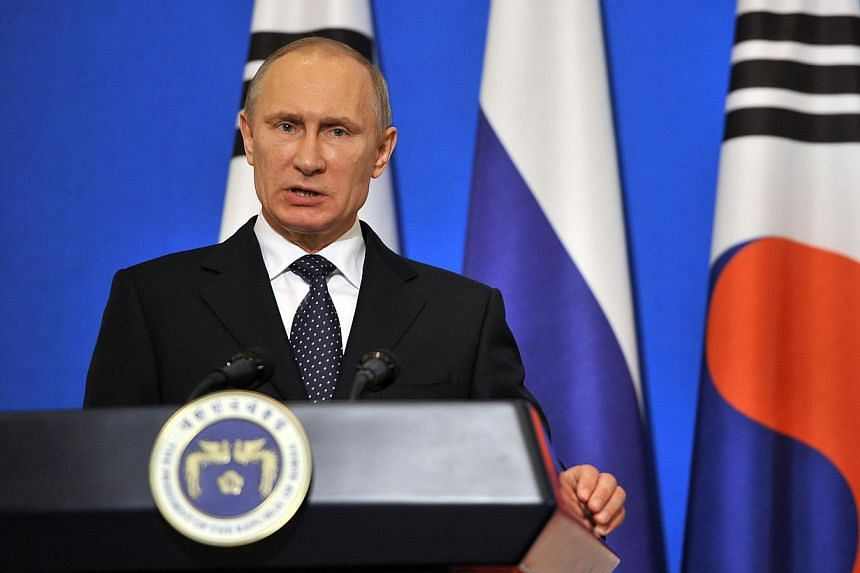 Russian President Vladimir Putin speaking during a joint news conference with South Korean President Park Geun Hye (not seen) at the presidential Blue House in Seoul on November 13, 2013. -- PHOTO: REUTERS