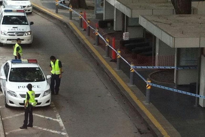 A bus-stop along Scotts Road was cordoned off by police for about two hours on Wednesday.-- PHOTO: ST READER