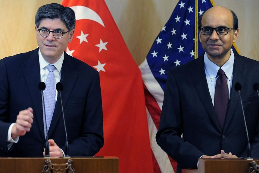 US Treasury Secretary Jack Lew (left) and Singapor Deputy Prime Minister and Finance Minister Tharman Shanmugaratnam attend a media briefing after their meeting in Singapore on Nov 13, 2013. Singapore and the United States are both com