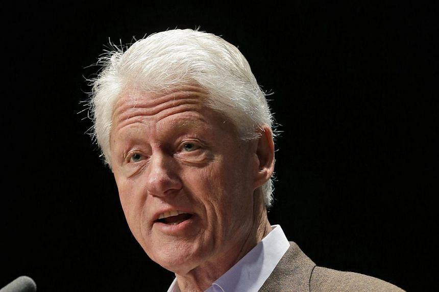 Former President Bill Clinton speaks in Charlottesville, Virginia., Oct 30, 2013.Mr Clinton weighed in on the crisis over the troubled new US health care law on Tuesday, handing President Barack Obama a new political headache. -- FILE PHOTO: AP