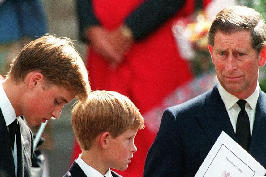 Prince Charles and this two sons Harry (centre) and William wait in front of Westminster Abbey in London after the funeral ceremony of Princess Diana on Sept 6, 1997. Prince Charles is readying the paperwork to claim his pension when he turns 65 on T