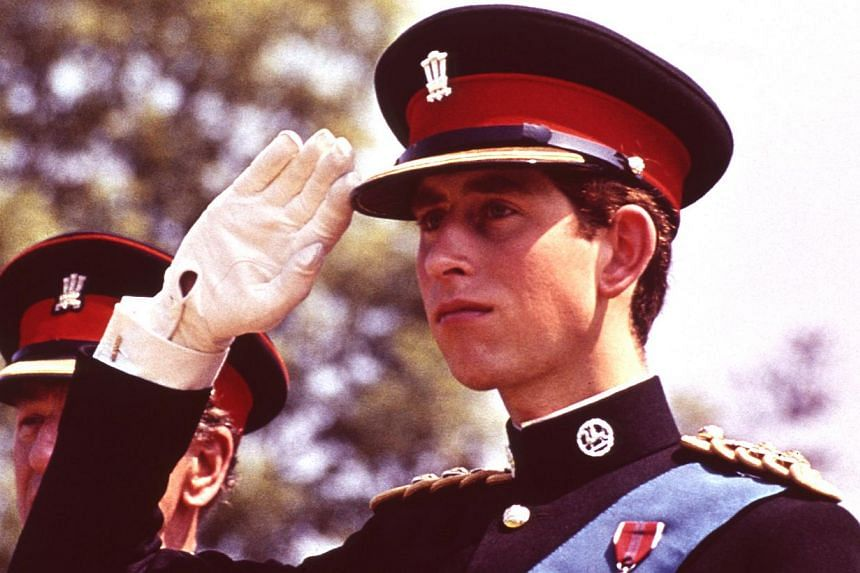 Prince Charles, in the uniform of the Colonel in Chief of the Royal Regiment of Wales, salutes at the Regiment's Colour presentation, at Cardiff Castle in Wales on June 11, 1969. Prince Charles is readying the paperwork to claim his pension when he t