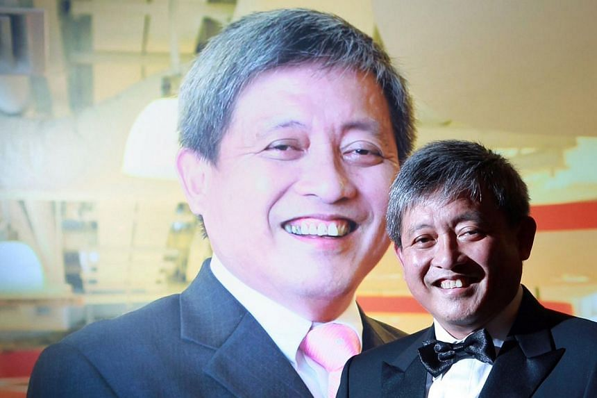 The chief executive of chocolate distributor and retailer Focus Network Agencies, Mr Paul Loo Lip Giam, is the overall winner of the Ernst & Young (EY) Entrepreneur of the Year award.-- ST PHOTO: NEO XIAOBIN