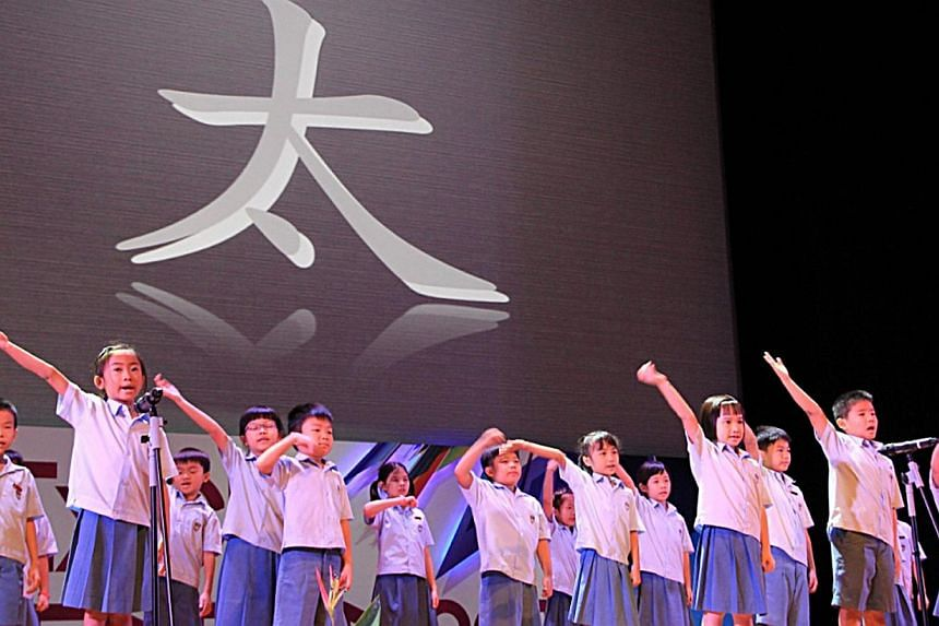 At Guangyang Primary School, lower primary students learn Mandarin by using simple hand and body movements to 'act out' the different strokes of the Chinese characters. -- PHOTO: PUBLIC SERVICE DIVISION/PRIME MINISTER'S OFFICE