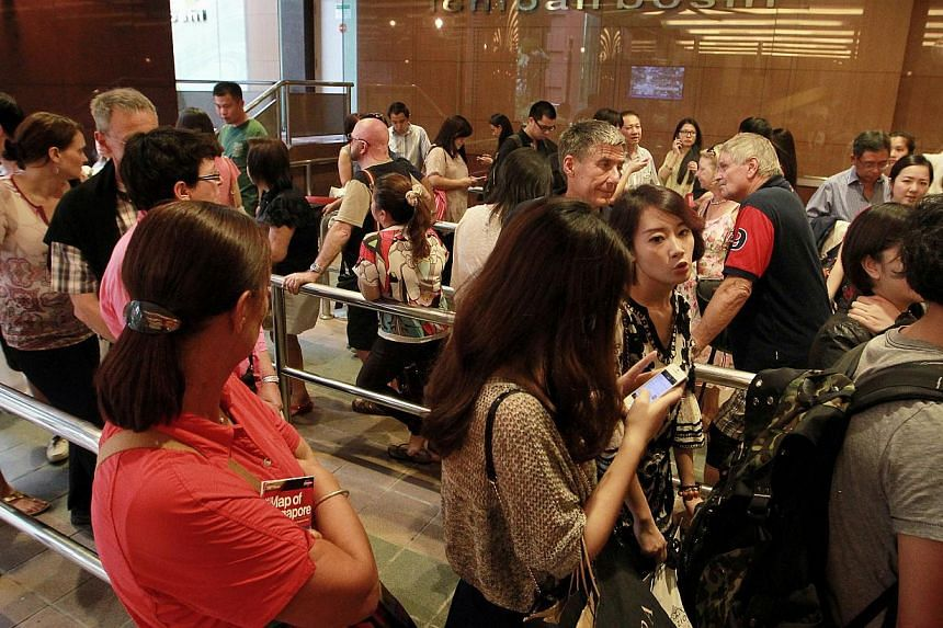 The queue at the Ngee Ann City taxi stand on a day last month. A joint effort with LTA last December to tweak traffic light timings so that more cars can exit the mall has only marginally improved traffic flow, said a Ngee Ann City spokesman. -- ST P