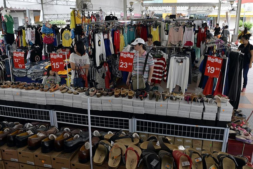 The Workers' Party-run town council has responded to complaints by shopkeepers in Hougang Central Hub that frequent trade fairs in the area have hurt their business. -- ST PHOTO: DESMOND FOO