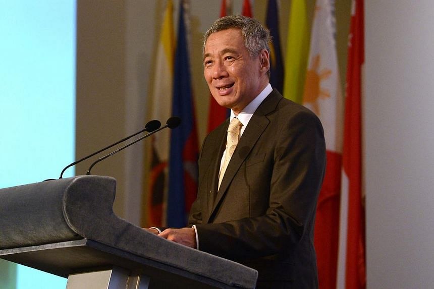 Prime Minister Lee Hsien Loong (above) will attend the three-day Commonwealth Heads of Government Meeting (CHOGM), with leaders keen to discuss common pressing concerns like balancing economic growth and social inclusion.-- ST PHOTO:NG SO
