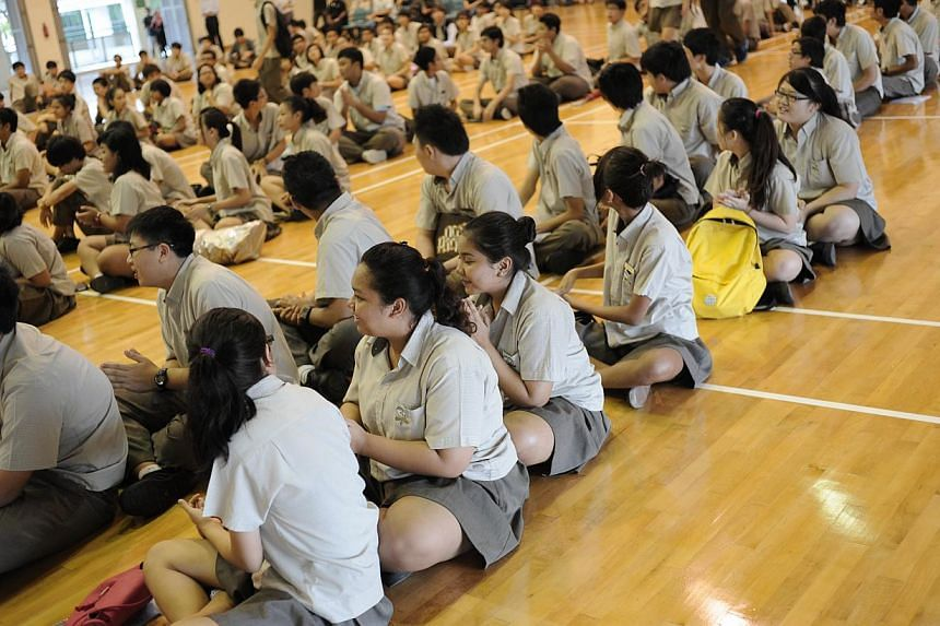 Students at Bedok Green Secondary School waiting to get the results for their N-level examinations on Dec 17, 2013. Bedok Green Secondary School is one of 12 secondary schools in which secondary 1 students in the Normal (Academic) and Normal (Technic