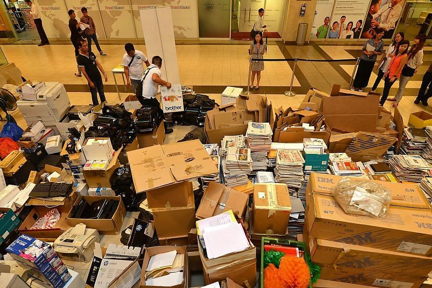 The collection point for recyclable items at Changi Terminal 2, on Friday, Nov 15, 2013. -- ST PHOTO: CAROLINE CHIA