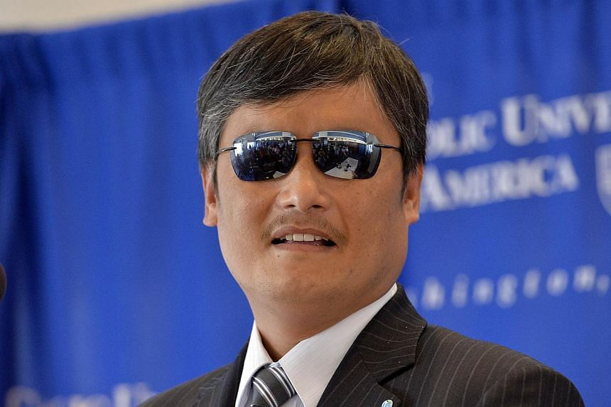 "China took credit on Friday, Nov 15, 2013, for its ""humanity"" in allowing blind legal activist Chen Guangcheng (above) to study in the United States, after he fled to the US embassy in Beijing following months of house arrest. -- FILE PHOTO: AFP"