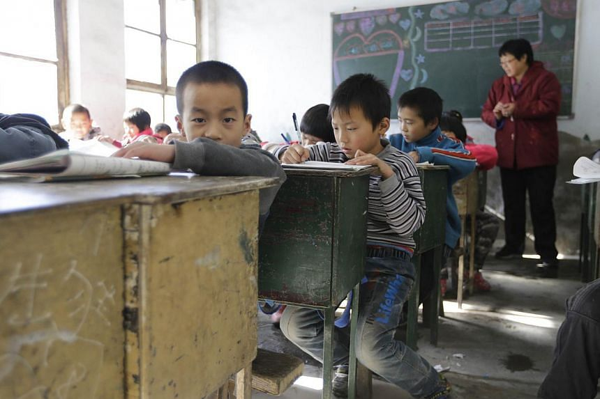 Students attend class at Pengying School on the outskirts of Beijing on Nov 11, 2013. China will relax its one-child policy, state media said on Friday, Nov 15, 2013, in a major policy shift announced days after the conclusion of a meeting of to