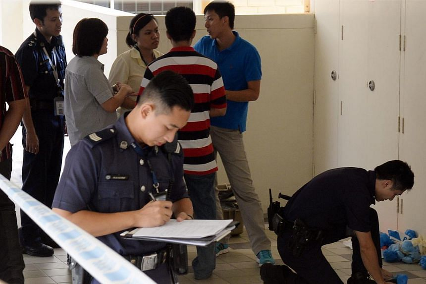 Police and CID officers outside the Tampines flat.The Indonesian maid who was arrested on Thursday, Nov 14, 2013, after the 16-year-old daughter of her employer was found dead with stab wounds in their Tampines flat, has been charged for murder