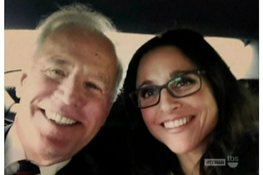 United States Vice-President Joe Biden snaps one with actress Julia Louis-Dreyfus, who appears as the fictional US Vice-President Selina Meyer on the TV show Veep. -- PHOTO: VULTURE