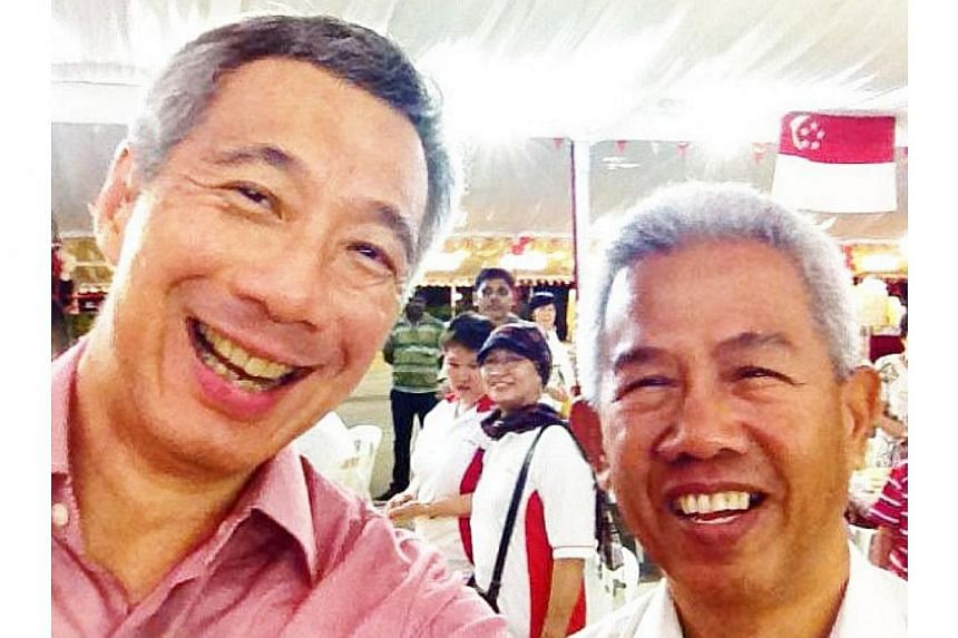 """This was one of the first pictures Prime Minister Lee Hsien Loong posted on his Instagram account, in May 2013. The accompanying caption was """"12Aug12: Very happy to meet an old SAF comrade. Omar was a vehicle electrician in my platoon in Taman Jurong"""