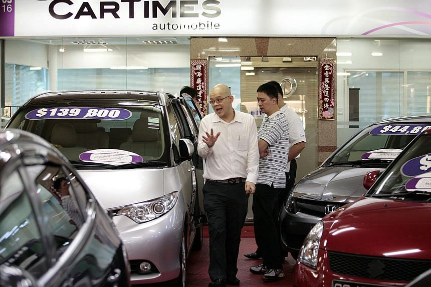 Retailers in Singapore saw their takings fall 5.9 per cent in September over a year ago, dragged down by slower sales of cars and telecommunications apparatus and computers. -- ST FILE PHOTO: JASON QUAH
