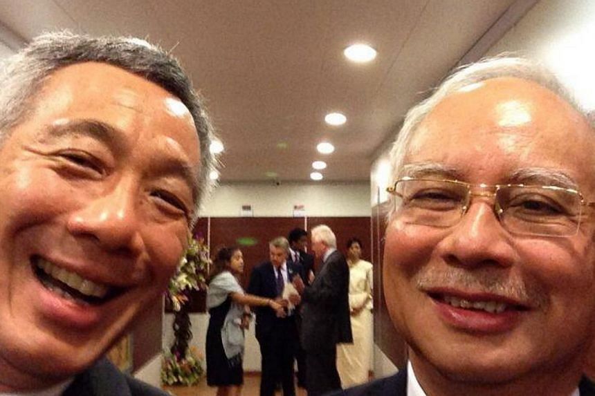 """Prime Minister Lee Hsien Loong (left) took a """"selfie"""" with his Malaysian counterpart Najib Razak at the start of the Commonwealth Heads of Government Meeting on Friday in Colombo, Sri Lanka.-- PHOTO: TWITTER OF PM LEE"""