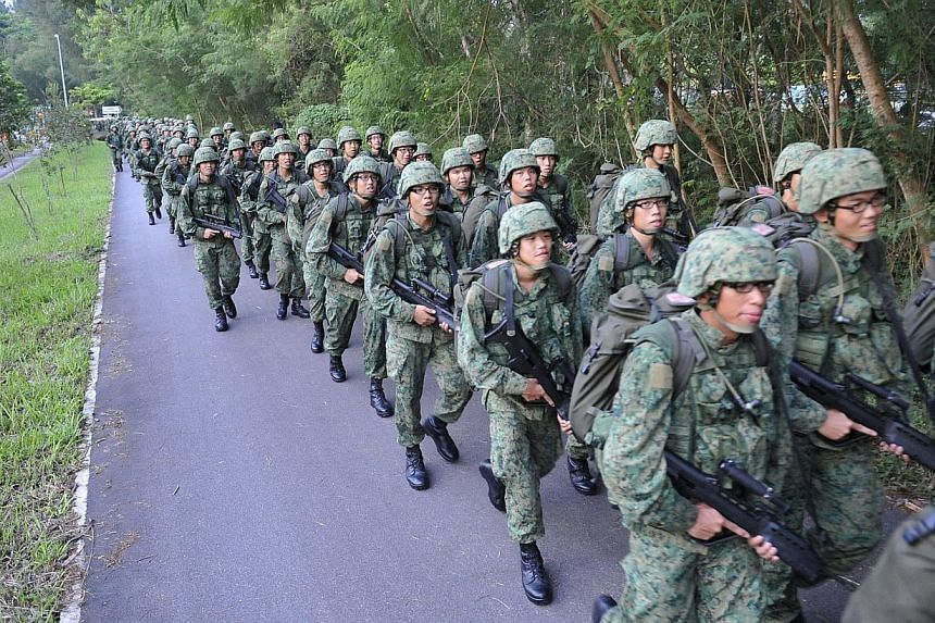 Graduating recruits from Pulau Tekong's Basic Military Training Centre (BMTC) set off from the Singapore Armed Forces Ferry Terminal along Changi Coast Road on Oct 1, 2010, for the seven-hour march along the eastern coastline and will arrive at the f