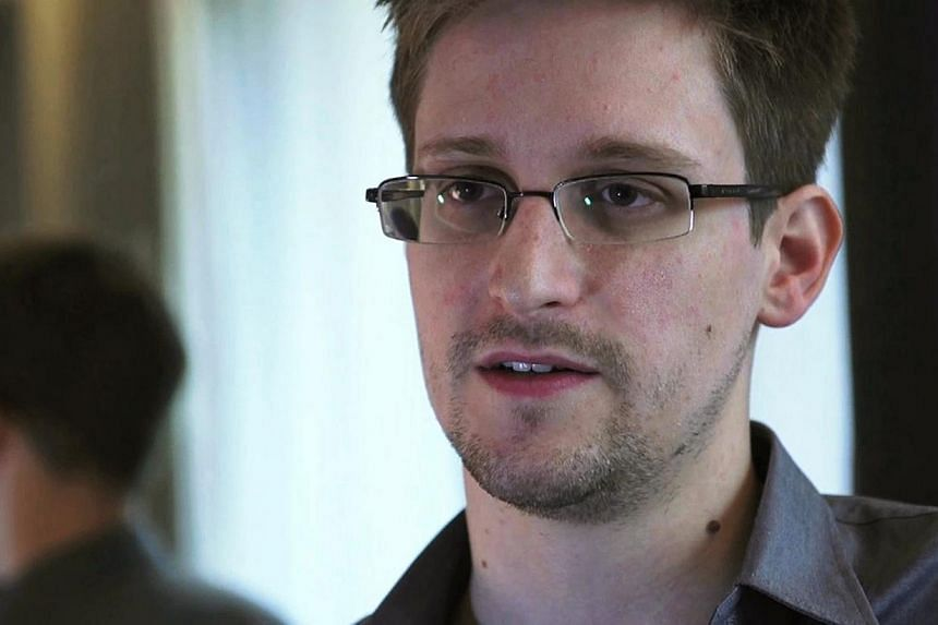 NSA whistleblower Edward Snowden, an analyst with a US defence contractor, is seen in this still image taken from video during an interview by The Guardian in his hotel room in Hong Kong on June 6, 2013. The US Justice Department has no plans to pros