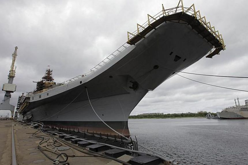 In this photograph taken on July 2, 2009, The Admiral Gorshkov, a Soviet-era aircraft carrier that was bought by India, is anchored in the Sevmash factory in the northern city of Arkhangelsk. Russia handed over a refurbished aircraft carrier to