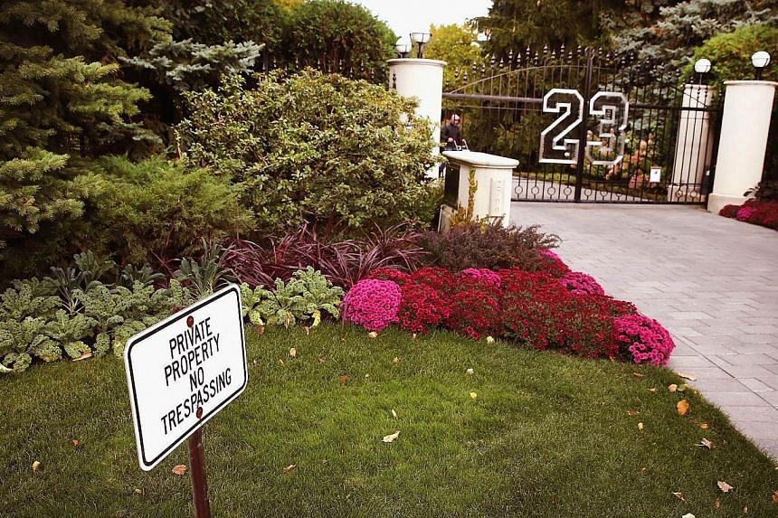 A gate with the number 23 controls access to the home of basketball legend Michael Jordan in this Oct 21, 2013, file photo in Highland Park, Illinois.Basketball great Michael Jordan's luxurious Chicago mansion will be sold at auction next week,
