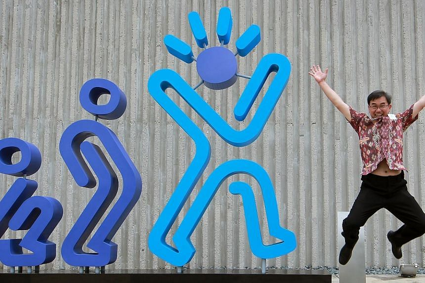 Mr Jack Sim, the founder of the World Toilet Organisation, a non-governmental group that has championed clean toilets and sanitation for over a decade, poses next to the art sculpture Evolution of Man: Poo Pee Happy, commissioned by World Toilet Orga