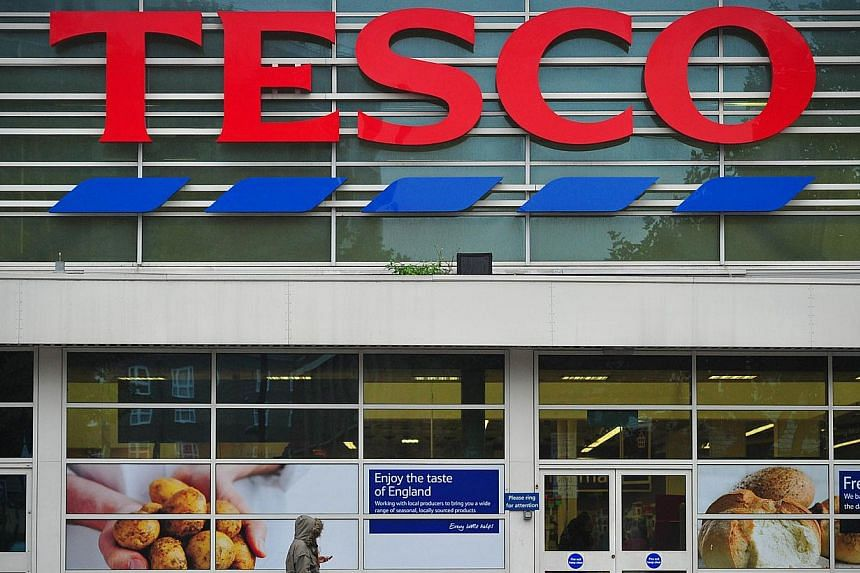 A Tesco's supermarket is pictured in south London, on Oct 2, 2013.Tesco, Britain's biggest retailer, on Friday recalled an ice cream product after pain relief tablets were found in two of its own-brand chocolate and nut cones. -- FILE PHOTO: AF