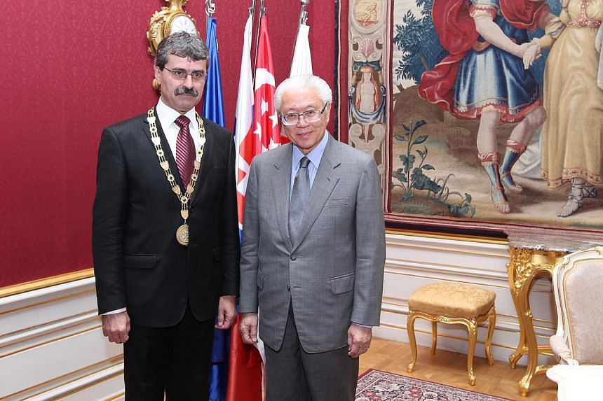 President Tony Tan with Mayor Milan Ftacnik at the Primate's Palace in Bratislava last Friday. Dr Tan visited the Slovak Academy of Sciences yesterday.