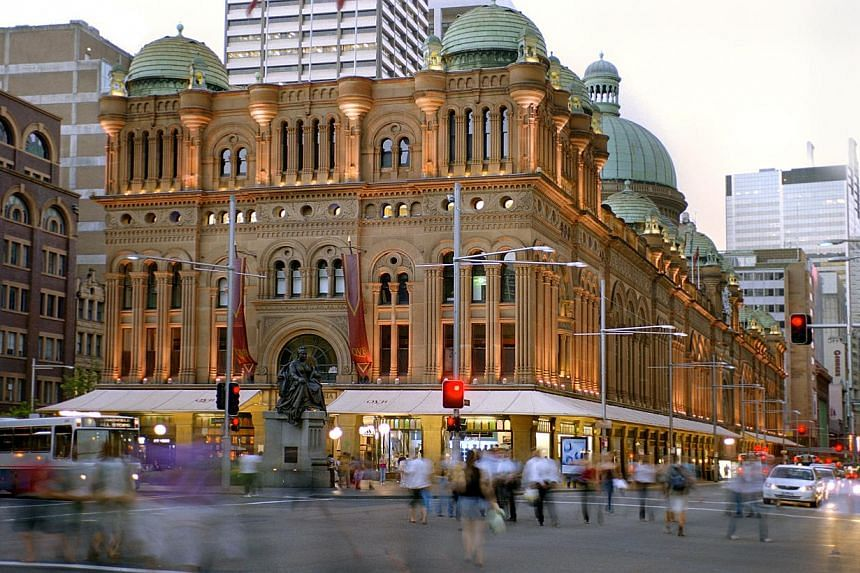 GIC's investments include Westin Paris and Queen Victoria Building (above) in Sydney, while Pontiac Land has a stake in a 72-storey condo next to the Moma. -- PHOTOS: GIC, PONTIAC LAND GROUP