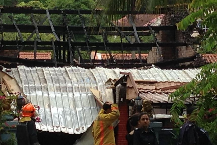 Two male bodies were discovered by firefighters after they put out a fire at a Bukit Timah bungalow in the early hours of Sunday morning.-- ST PHOTO: YEO SAM JO