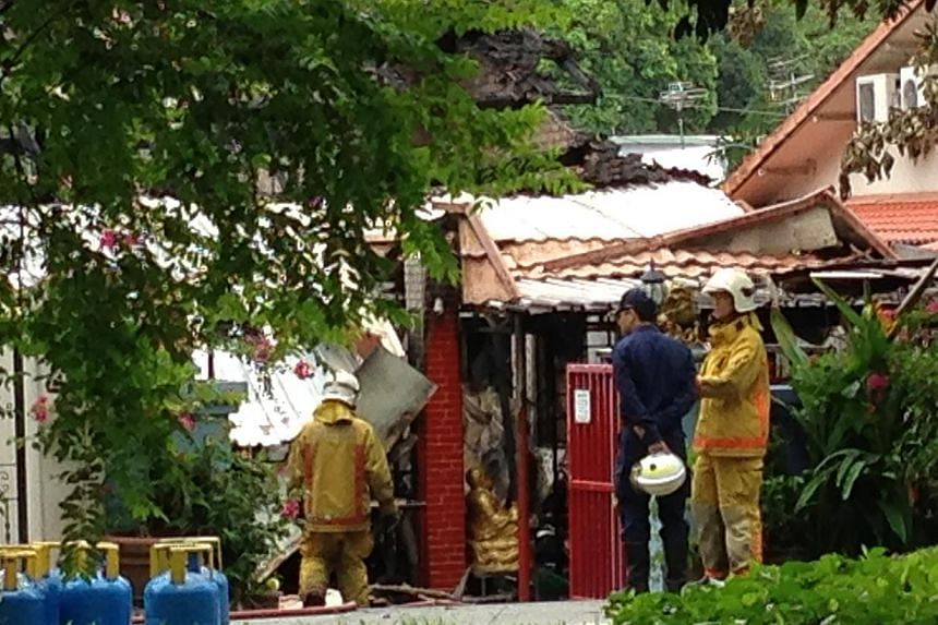 Two male bodies were discovered by firefighters after they put out a fire at a Bukit Timah bungalow in the early hours of Sunday morning. -- ST PHOTO: YEO SAM JO