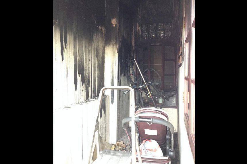 Neighbours Mr and Mrs Mackay's house (42 Jalan Gaharu). The back of their rented house burnt black. Mr Mackay's two mountain bikes were melted by the fire. Behind the bikes is the bedroom of one of the Mackays' two-year-old twin girls, which was also