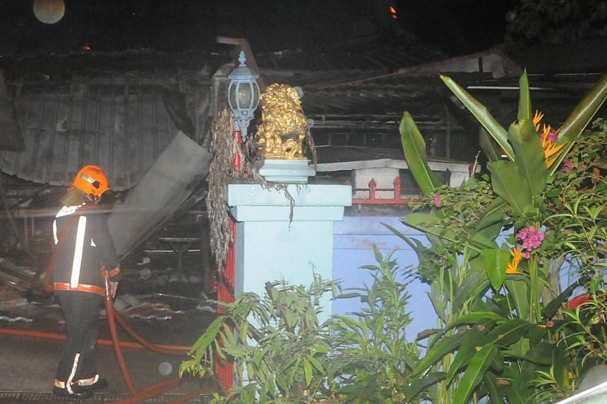 Two male bodies were discovered by firefighters after they put out a fire at a Bukit Timah bungalow in the early hours of Sunday morning.-- PHOTO: SCDF