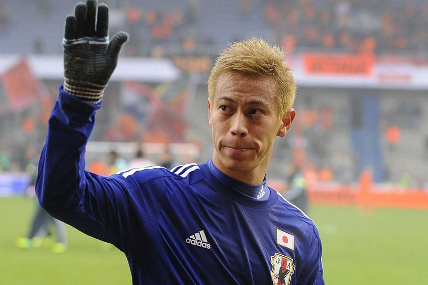Japan midfielder Keisuke Honda celebrates on Nov 16, 2013, after a World Cup 2014 friendly football match against the Netherlands at the Cristal Arena in Genk. An inspirational Keisuke Honda steered Japan from two goals down to a creditable 2-2 draw