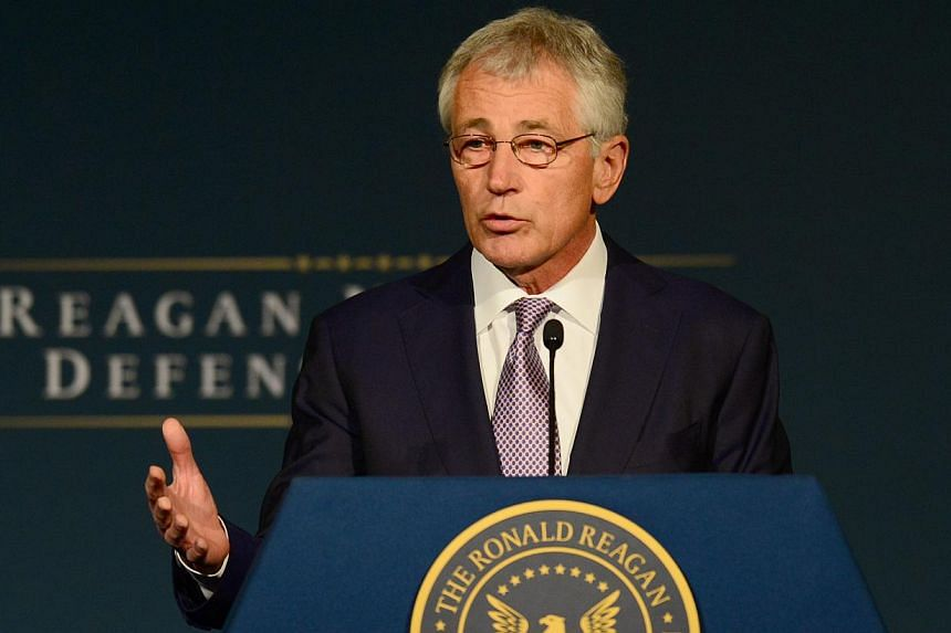 US Defence Secretary Chuck Hagel gestures while making Keynote remarks during the Reagan National Defense Forum at the Ronald Reagan Presidential Library in Simi Valley, California on Nov 16, 2013. Mr Hagel sounded an alarm bell about budget cuts he