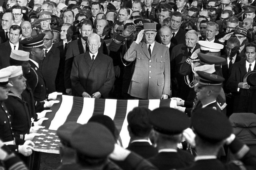In this Monday, Nov 25, 1963 file photo, President Charles de Gaulle of France (centre) and other dignitaries salute as servicemen hold an American flag above the casket of President John F. Kennedy in Arlington National Cemetery in Arlington, Virgin
