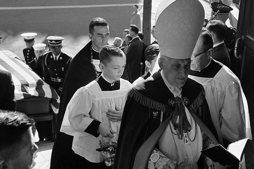 In this Monday, Nov 25, 1963 file photo, Cardinal Richard Cushing leads the procession bearing the coffin of President John F. Kennedy into St. Mathew's Cathedral in Washington. -- FILE PHOTO: AP