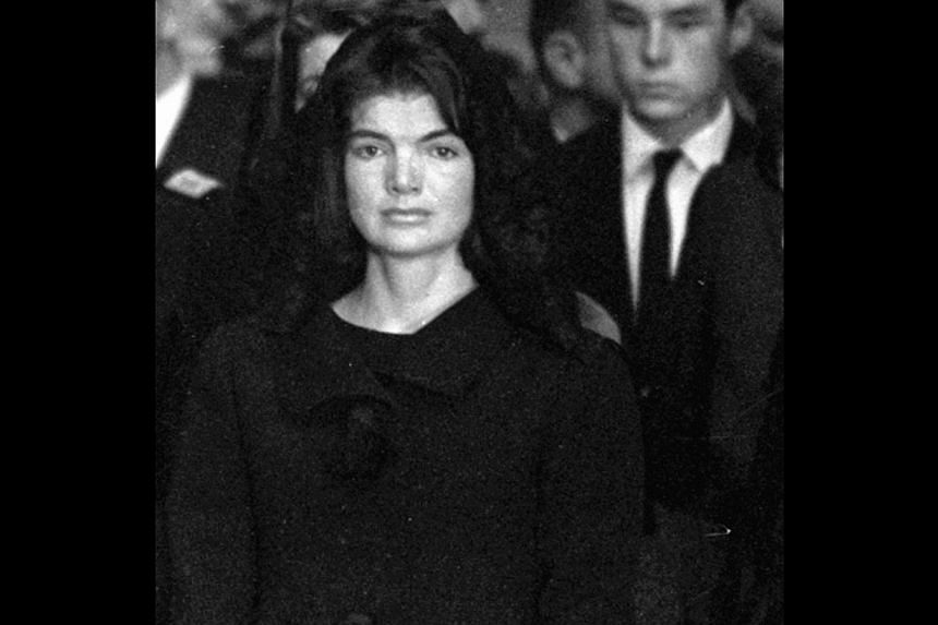 In this Sunday, Nov 24, 1963 file photo, Jacqueline Kennedy looks toward the casket of her slain husband, President John F. Kennedy, during eulogies in the Capitol rotunda in Washington. -- FILE PHOTO: AP