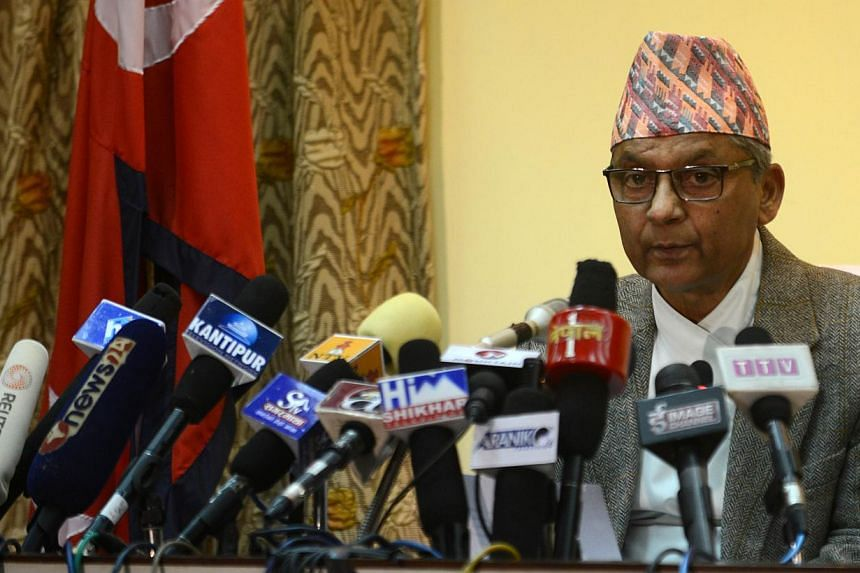 Nepalese chairman of the Interim Council of Ministers Khil Raj Regmi makes his address to the nation at Singhadurbar in Kathmandu on November 17, 2013. Millions of Nepalis will brave threats of violence and head to the polls on November 19, hoping a