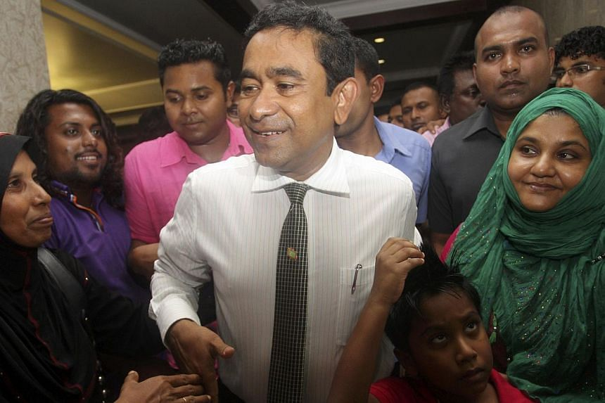 Newly elected Maldives President Abdulla Yameen is surrounded by supporters at his party's headquarters on election day at Nasandura Palace Hotel in Male, Nov 16, 2013. -- PHOTO: REUTERS
