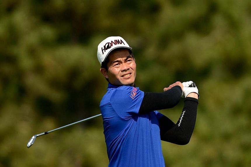 China's Liang Wenchong (above) birdied the final hole to force a play-off with Thailand's Prom Meesawat before going on to claim a third Asian Tour title at the inaugural Manila Masters on Sunday. -- PHOTO: AFP