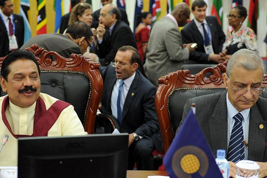 (From left) Sri Lankan President and Mahinda Rajapakse, Australian prime minister Tony Abbott and Secretary General of the Commonwealth of Nations, Kamalesh Sharma attend the final working session of the Commonwealth Heads of Government Meeting (CHOG
