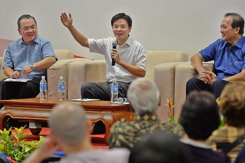 Acting Minister for Culture, Community and Youth Lawrence Wong(centre) having a dialogue session with residents at Siglap South CC after a ministerial visit around Joo Chiat constituency. With him are Joo Chiat MP Charles Chong (right) and Citizens'