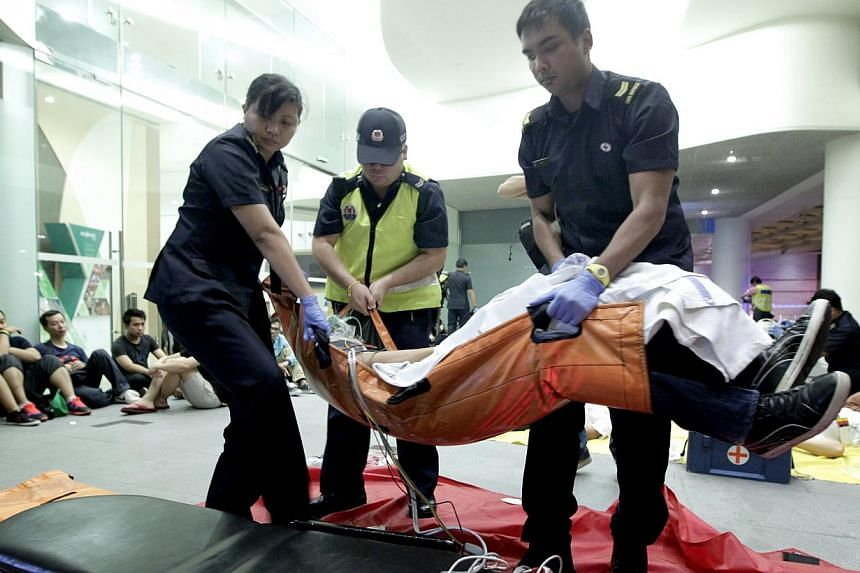 The Singapore Police Force on Monday conducted an emergency preparedness exercise, codenamed Exercise Heartbeat, involving the SPF, SCDF, and Safety and Security Watch Group (SSWG), to test responses against terrorist threats. -- ST PHOTO: CHEW SENG