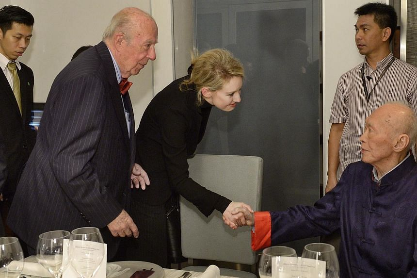 Mr Lee Kuan Yew shakes hands with Ms Elizabeth Holmes, founder of US heatlh start-up Theranos. Mr Lee hosted a dinner for his old friend George Schultz (Second from Left), former United State Secretary of the Treasury and Secretary of State on M