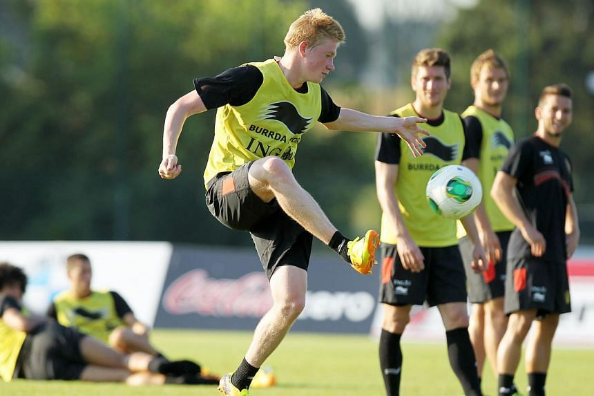 Belgium's Kevin De Bruyne (centre) attends on Sept 4, 2013, a training session of the Belgian national football team, the Red Devils, in Brussels ahead of a 2014 Fifa World Cup qualification match against Scotland on Sept 6 in Glasgow.Belgium a