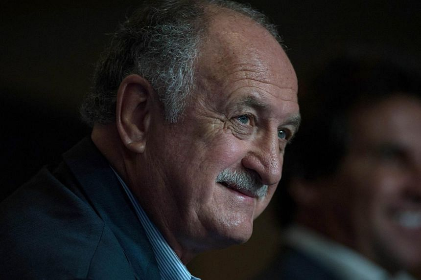 Brazil boss Luiz Felipe Scolari (above) believes England could be one of his country's main rivals when the South American nation stages next year's World Cup finals. -- FILE PHOTO: AFP