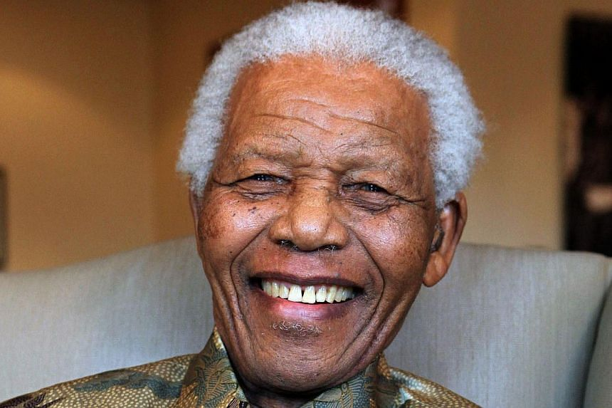 """South Africa's government on Monday, Nov 18, 2013, said former president Nelson Mandela (above) remains in a """"stable but critical"""" condition, but """"continues to respond to treatment,"""" in the first official health update since September. -- FILE PHOTO:"""