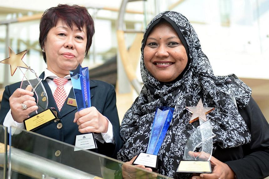 Ms Alice Lau Yin Fun (left), Guest Relation Officer of Hotel Royal Limited and Ms Siti Hawa Bte Hussein, Admin Assistant of Costa Sands Resort (Sentosa) with their Excellent Service Awards on Monday, Nov 18, 2013.Close to 2,700 service professi